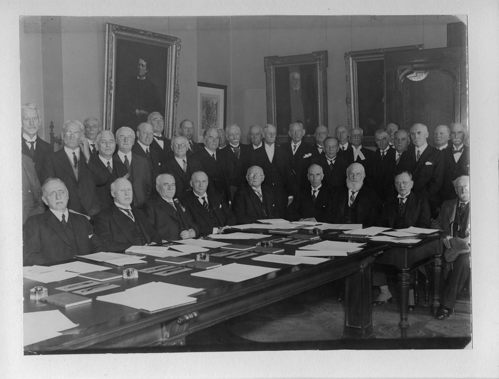 <p>Portraits remain an important part of the décor of the Law Society's boardroom. Photograph of meeting of benchers and judges for the Call to the Bar of the Rt. Hon. R.B. Bennett, 1932</p>