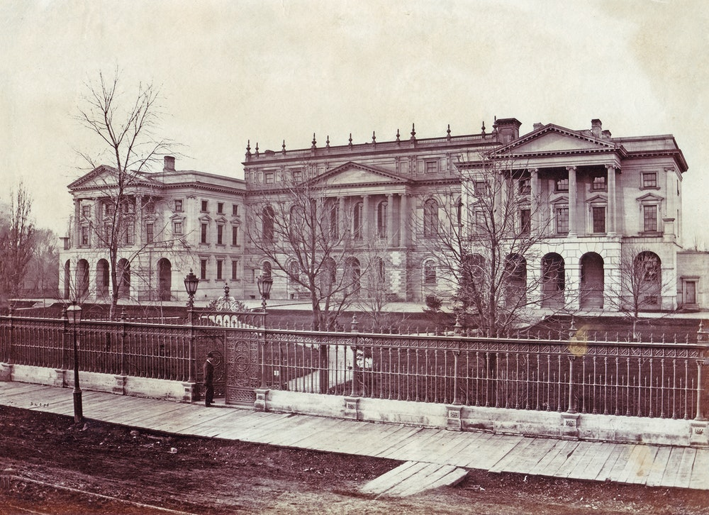 <p>Osgoode Hall from Queen Street West, 1868. The centre part was barely 10 years old and the iron fence had been completed the year before.</p>