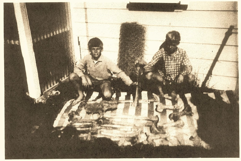 <p>Ray Prebble and Chris Dempsey pose with the moa bones outside Ray's batch in Waikaremoana.</p>