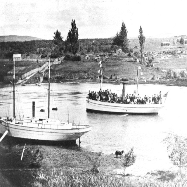 <p>A few days after the maiden voyage the official trial took place over the length of the lake. Fourteen young men performed a haka in honour of the occasion. It was a fine morning but half an hour into the trip the lake became very rough. Most of the passengers were Māori (hapū Ngati Hinerau). Quite a number became frightened and were sea sick. When it was time to return from Tokaanu some rode back on horse-back rather than go back on the boat. It took some a week to make it back to Taupō.</p><p>Note the 'Tauhara' at mooring. SS Tongariro with its ability to handle adverse weather and maintain a regular service, took the mail service away from the 'Tauhara'.</p>