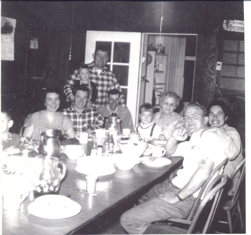 <p>Adobe Kitchen and Dining Area. Pictured here is the Takens family dining together, circa 1960.</p>
