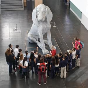 <p>Guided student tour group learning about Scott Fife's <em>Leroy, The Big Pup</em>.</p>