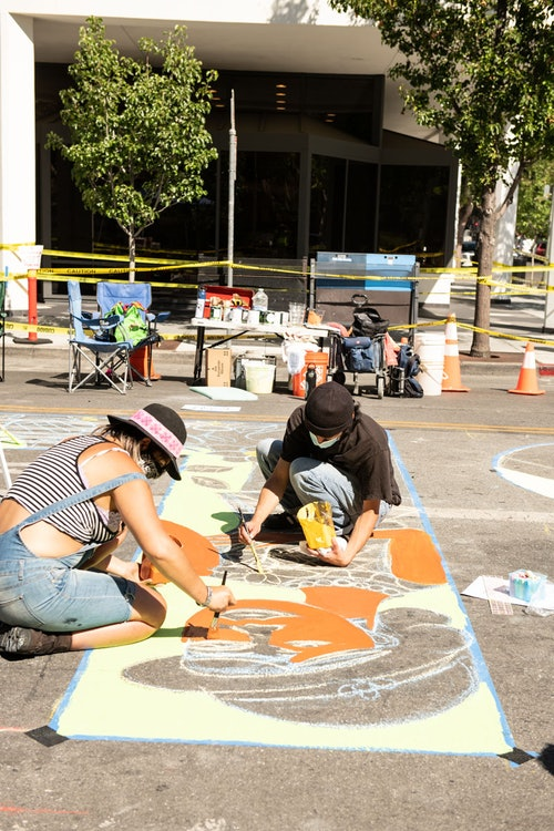 """<p>Sasha Vu painting the letter """"L"""" of the BLM Mural</p>"""