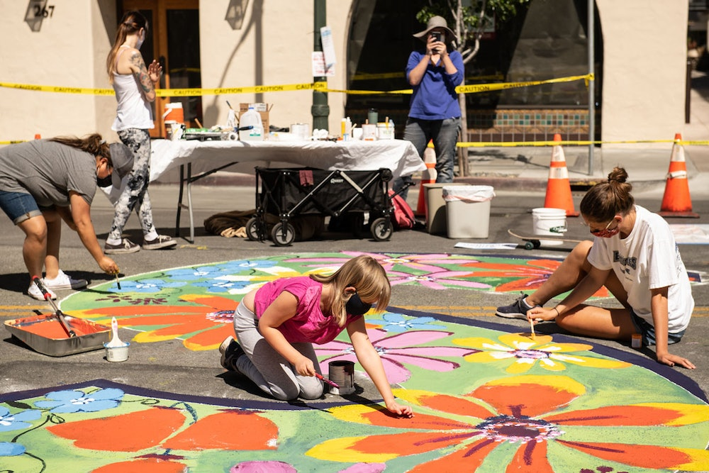"""<p>Artist Ann McMillan with her daughter and volunteers painting the letter """"S"""".</p>"""