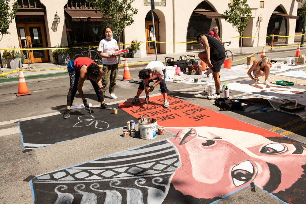 """<p>Artist Cece Carpio and family painting the letter """"E"""". </p>"""