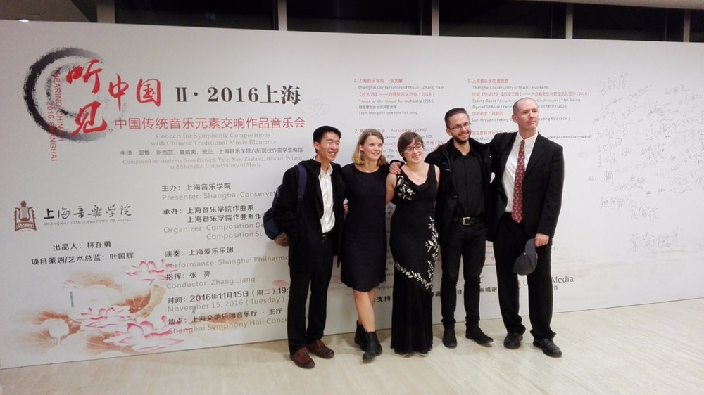 <p>Louisa Nicklin (second from left) pictured with other invited young composers at the Shanghai Symphony Hall. Image courtesy of Te Kōkī New Zealand School of Music.</p>