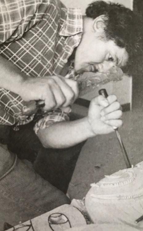 <p>Takirirangi Smith demonstrates the use of the pataki chisel. </p>