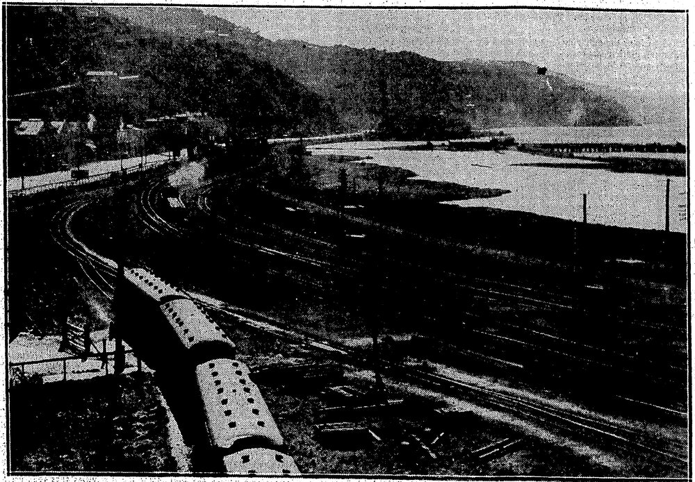 <p><em>View of early Wellington showing the progress of made up to that time with the reclmation at the Thorndon end of the city. In the foreground is Hill Street, and on the right are the Government Buildings.</em> Source: Evening Post, 27 February 1932. Alexander Turnbull Library, Wellington, New Zealand. Some rights reserved https://natlib.govt.nz/records/17041989</p>