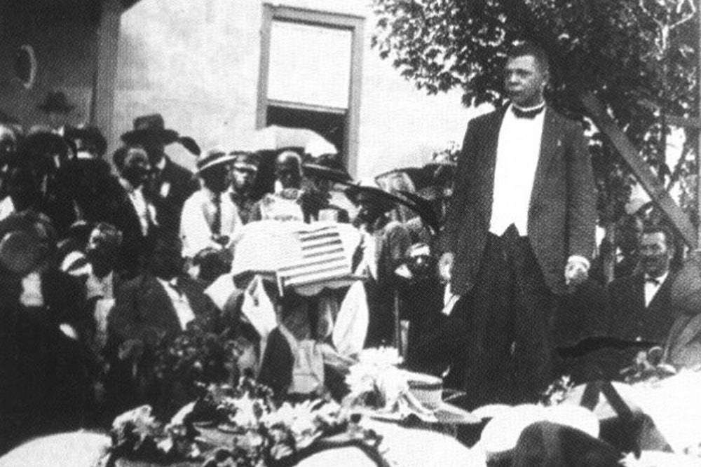 <p>Booker T. Washington speaks to a gathering of almost 5,000 locals at Christiansburg Industrial Institute in 1909.</p>