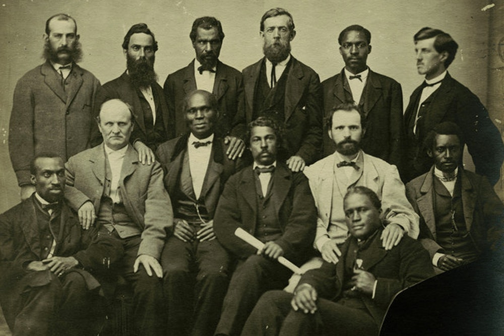 <p>Part of the petit jury empanelled to try Jefferson Davis for treason, ca. May 1867. Landon Boyd standing in rear of image, 5th from right.</p>