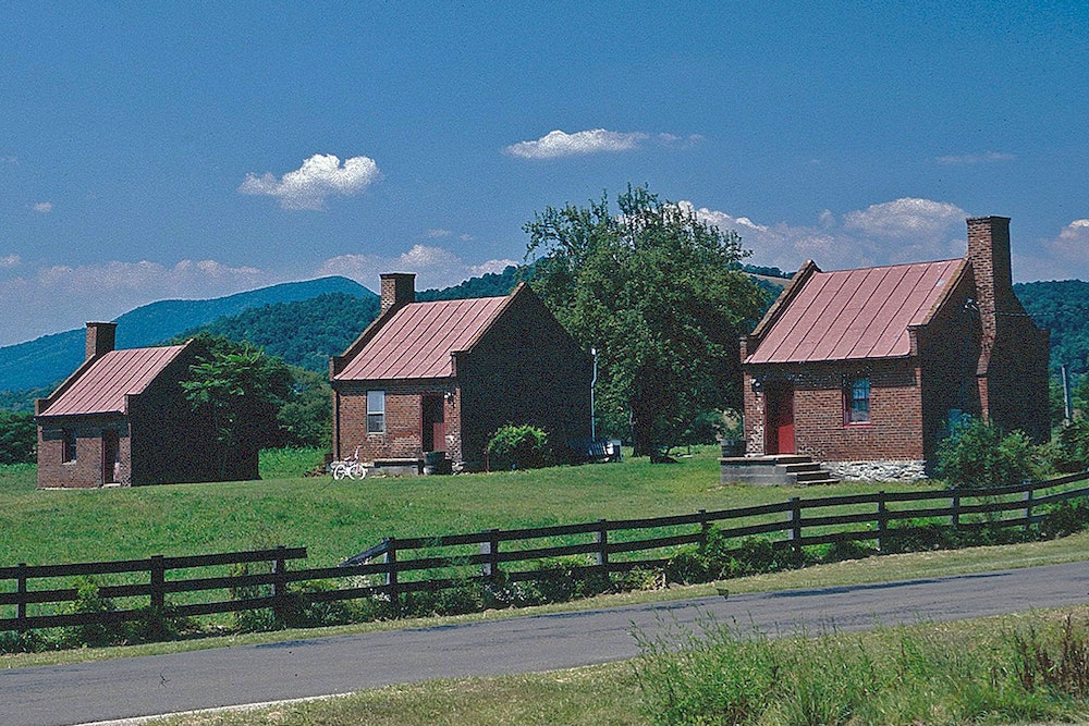 <p>Slave cabins at Ben Venue stand on a the hilltop amidst Blue Ridge Mountains.</p>