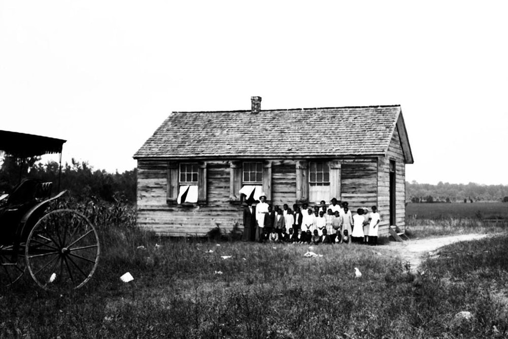 <p>This image, likely from the early 20th century, shows noted educator Virginia Randolph and students outside the school in Gravel Hill.</p>