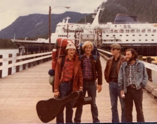 <p>Tom, 2nd from right, greeting friends in Petersburg, Alaska</p>
