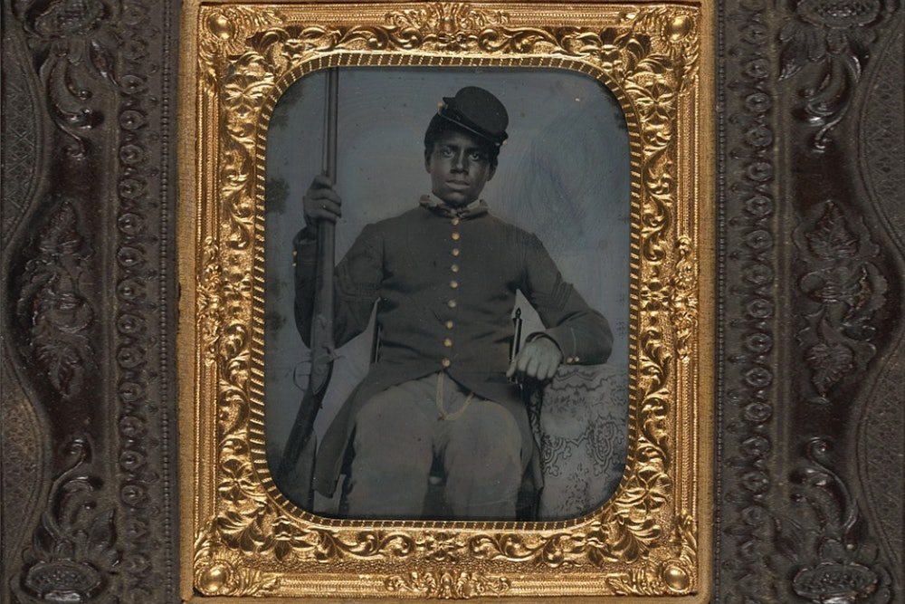 <strong>Unidentified African American soldier in Union sergeant uniform holding a rifle</strong>