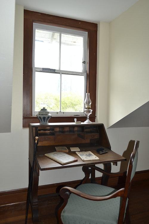 <p>Desk in replica hotel room in New River Inn.</p>
