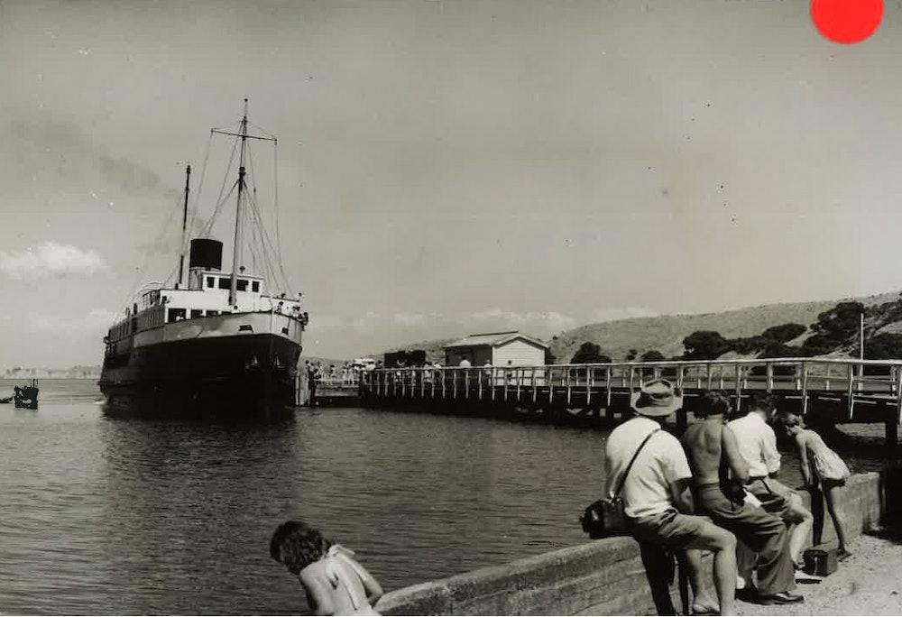 <p>Muritai alongside Matiatia Wharf, January, 1957. <em>W. Walker, Alexander Turnbull Library - F330991/2.</em></p>