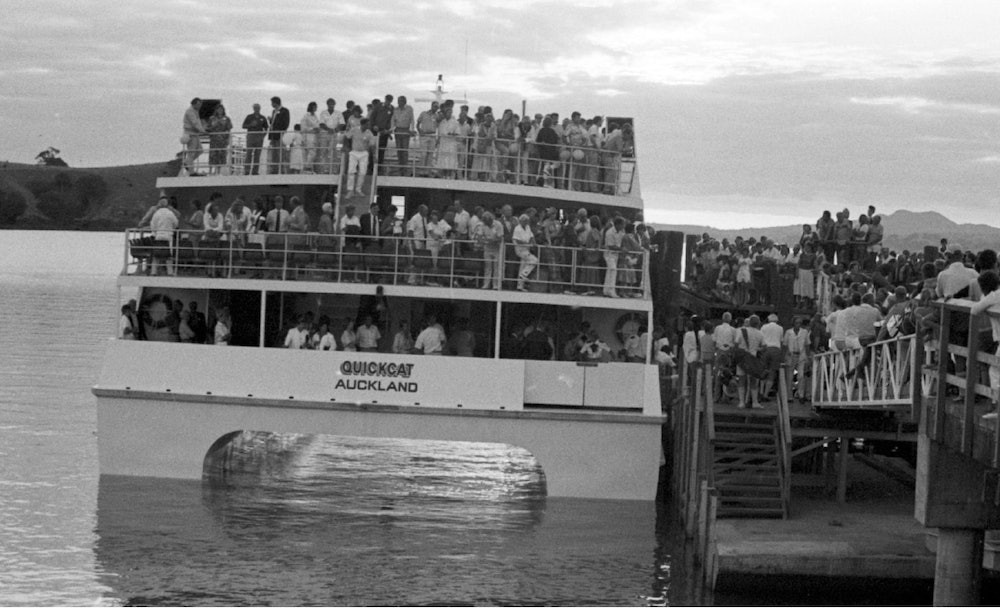 <p>Quickcat berthing at the wharft, Matiatia, packed with holidaymakers. <em>Gulf News, 30th October, 1987.</em></p>