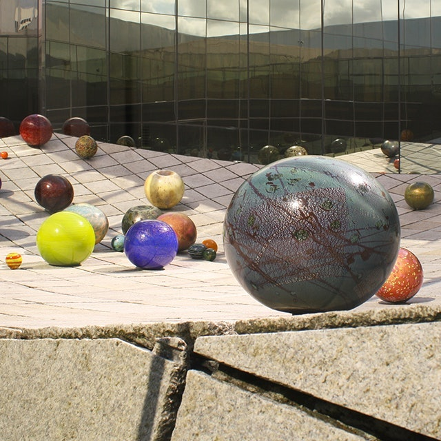"""<p>Richard Rhodes' Untitled """"stone wave"""" sits at the heart of the museum. During the summer, Dale Chihuly's Ma Chihuly's Floats are displayed on the wave.</p>"""