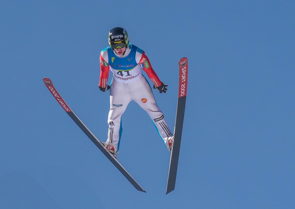 <p>Harris Hill Ski Jumper (in the sky). Photo by Doug Learned</p>