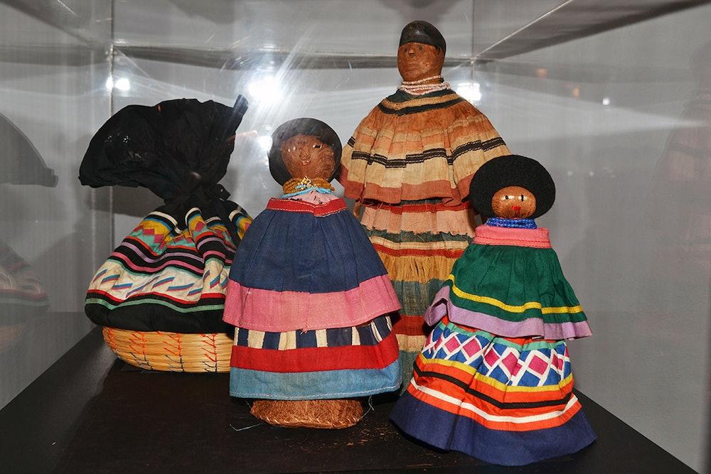 <p>Seminole patchwork dolls and basket.</p>
