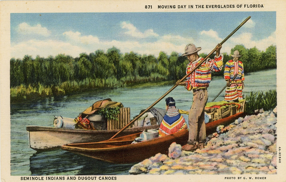 <p>Postcard depicting Seminoles and dugout canoes.</p>