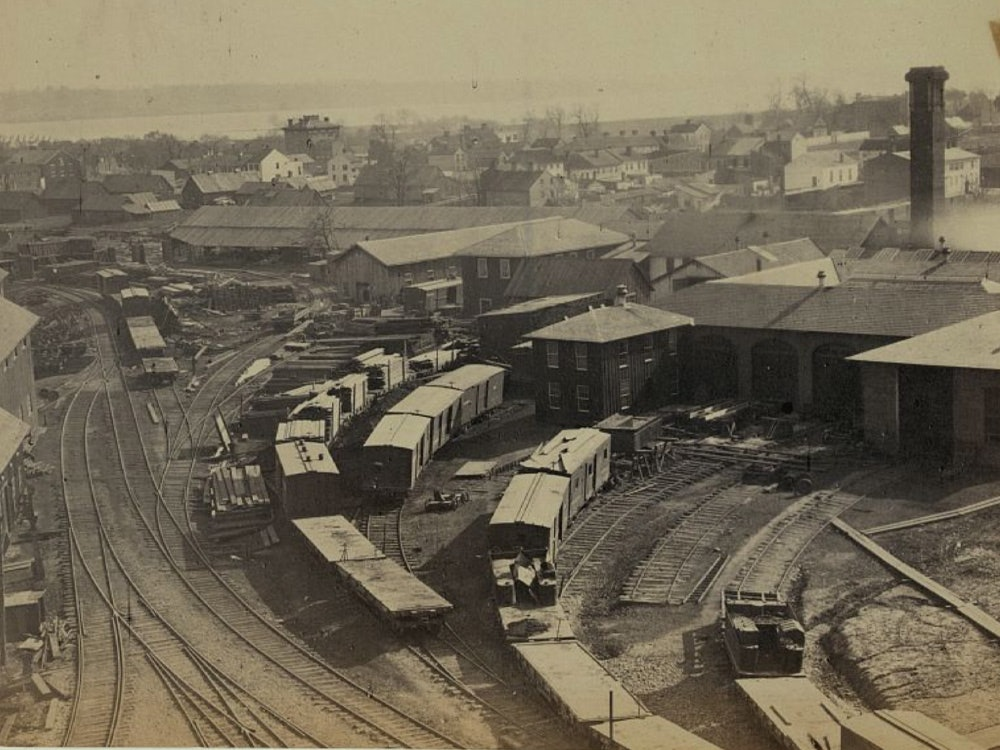 <p>Photograph shows a railroad yard of the Orange &amp; Alexandria Railroad in Alexandria, Virginia. Photograph taken from the top of the roundhouse.</p>