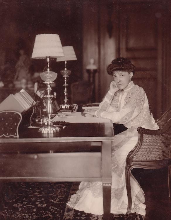 <p>Edith Wharton at her desk at The Mount, circa 1905</p>