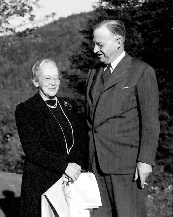 <p>Amy and Howard Rice outside their house on Chestnut Hill with Mt. Wantastiquet in the background. (Rice family photo)</p>
