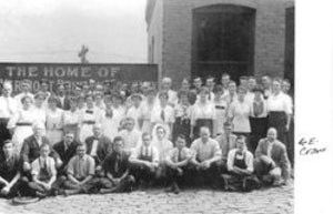 <p>Vermont Printing Company employees gather in front of The American Building Annex. Founder and president Ephraim Crane is in the front row, far right. (Crane/Irish family photo)</p>